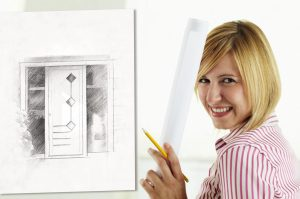 portrait of young adult architect holding blueprint and smiling. Copy space